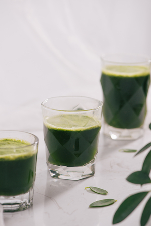 Healthy green smoothie. Natural, organic healthy juice in bottle for weight loss diet