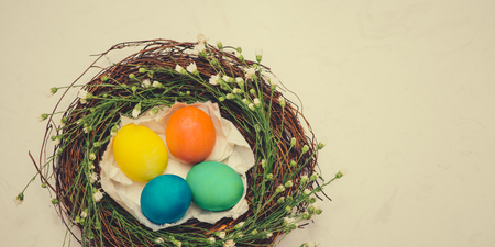 Banner. Easter eggs in beautiful nest on marble background. Stock Photo