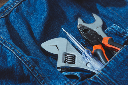 Jeans, repair equipment and many handy tools. Top view with copy space