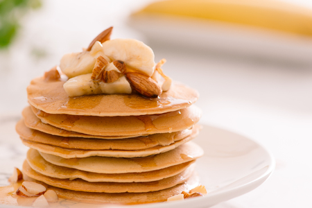Breakfast. Banana pancakes with honey and nuts Reklamní fotografie