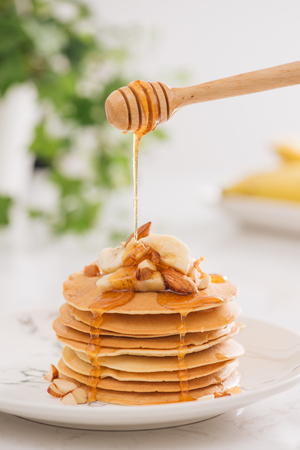 Banana cashew pancakes with bananas and caramel sauce.