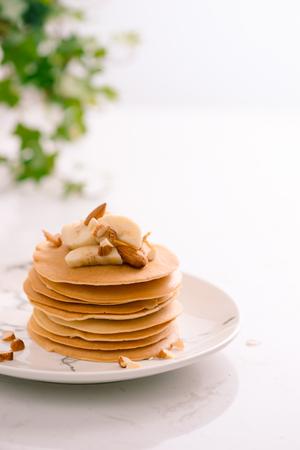 Banana cashew pancakes with bananas and caramel sauce.