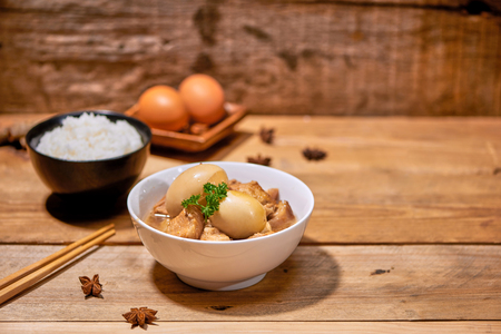 Vietnamese caramelised pork with hard-boiled eggs braised in coconut water. Stockfoto