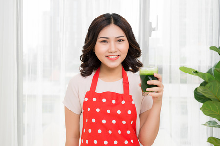 Young asian woman enjoy healthy vegetarian smoothie for weight loss and detox Stok Fotoğraf