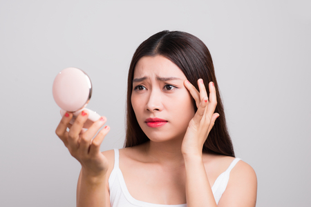 Sad asian woman with trouble of her skin.