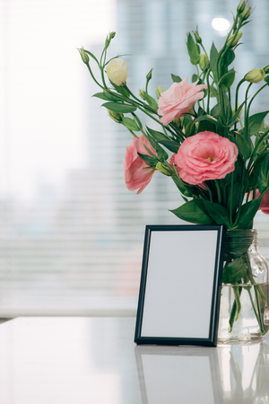 Lisianthus bouquet in the room  with blank note
