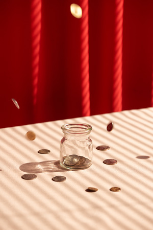Coins in glass jar. Money savings concept Banque d'images - 97961194