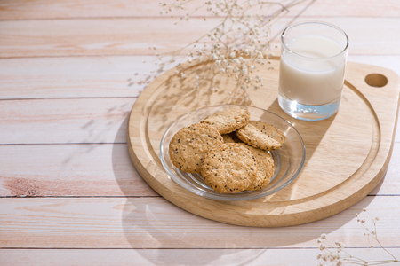 Dairy products. Pastry organic breakfast with milk and cookies. Stock Photo