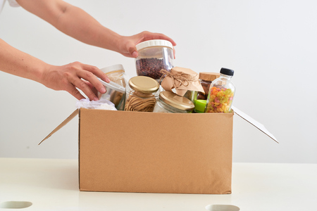 Volunteer with box of food for poor. Donation concept. Zdjęcie Seryjne