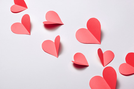 Beautiful pink paper hearts on white paper background Stock Photo - 97962410