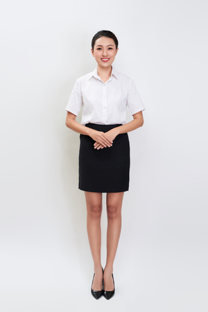Full body portrait of happy smiling young beautiful business woman Banco de Imagens