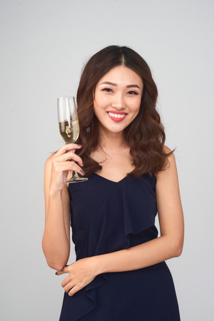 Beautiful young woman holding glass of champagne