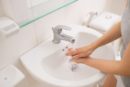 Washing, womens hand with soap under the crane with water Stock Photo