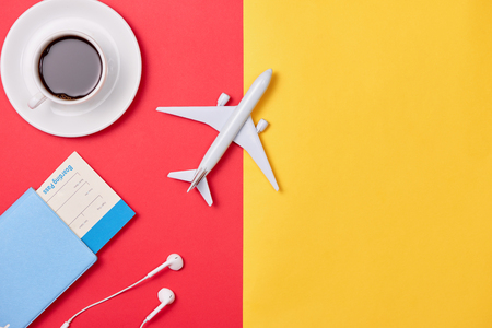 Online travel booking concept. Airplane model and passport on wooden background. 写真素材
