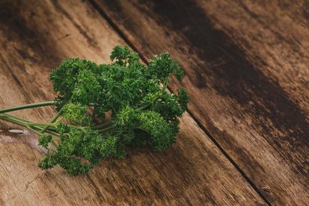 tied fresh parsley on wooden surface Reklamní fotografie