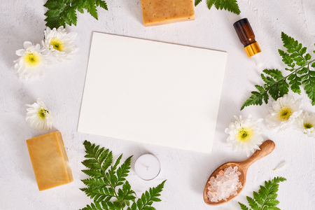Bathroom salt, soap and aroma oil for spa on white background top view mock-up Stock Photo