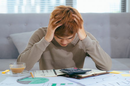 Stressed Asian Business man due to the of amount of work he has to do. Reklamní fotografie - 99234835