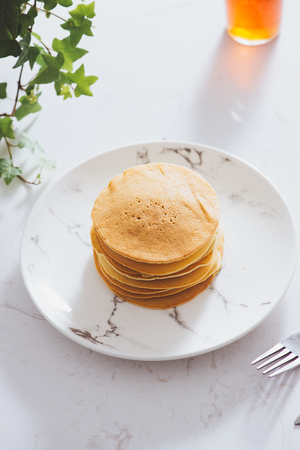 Cooking for breakfast. Delicious homemade pancakes on a plate  Stock Photo