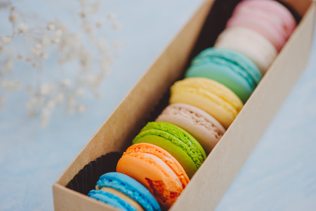 Delicious french dessert. Colorful pastel cake macaron or macaroon