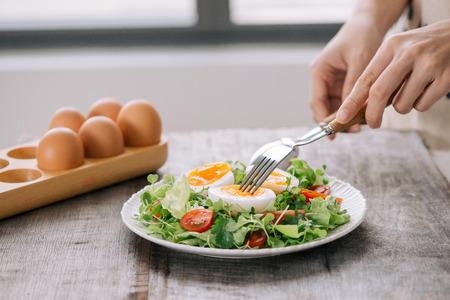 Lambs lettuce salad, hard-boiled eggs, tomatoes and honey mustard dressing