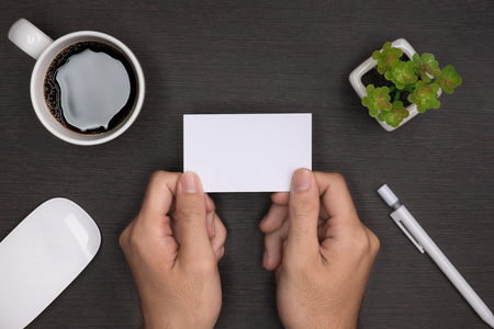 Mockup of white business cards in mans hand
