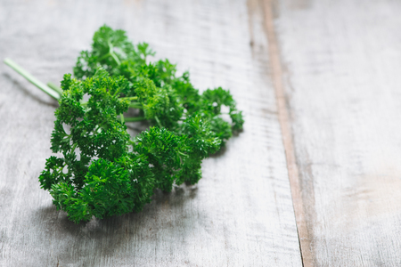 Healthy of Parsley on wooden table background, selective focus.