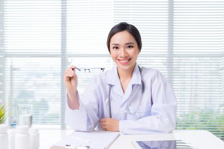 Female oculist giving a pair of eyeglasses
