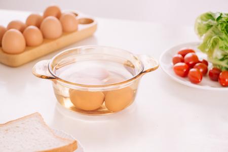 Healthy breakfast consisting of toast, eggs, salad, tomato Stock fotó