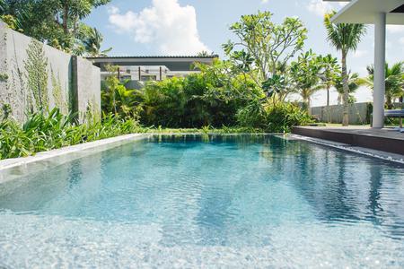 Tropical beach resort. Swimming pool near living room Фото со стока
