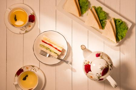 Afternoon tea table. tea set with sandwiches Foto de archivo - 100900235