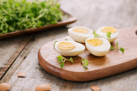 Slicing the hard-boiled eggs in two Stock Photo