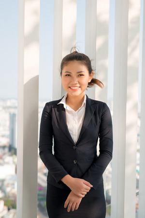 Young asian businesswoman in suit stading outside. Stock Photo