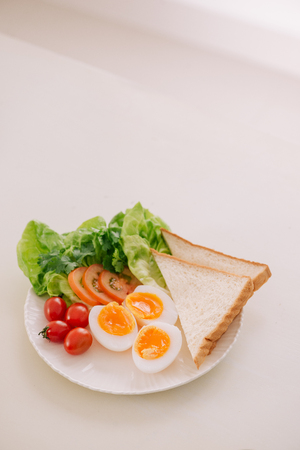 Fresh garden salad with egg, avocado and tomato in brownstone dish for a healthy low calorie lunch. Reklamní fotografie