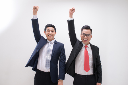 Successful Asian business man hands up feeling happy or win with background, Start up, Smart working, Success people, Partner and Teamwork concept