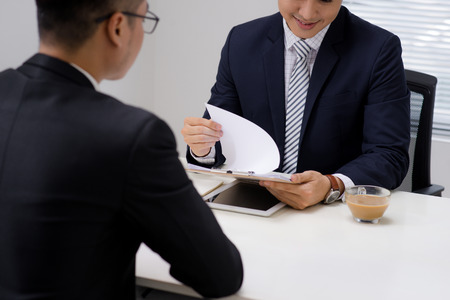 Salesman explaining his idea of overcoming crisis to co-worker