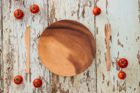 Empty round wooden plate on wood table background