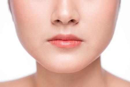 Young asian woman close up. Perfect natural lip makeup Stock Photo