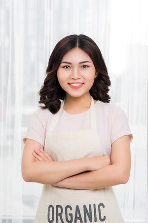 Female chef posing with her arms crossed.