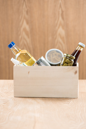 donation box with food stuffs on wooden background Standard-Bild - 101745652