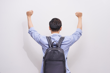 Back view of man with backpack posing with hands up on white background