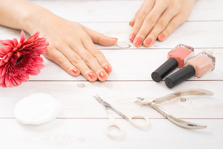 Nail care and manicure. Beautiful female hands with pink nail polish 스톡 콘텐츠