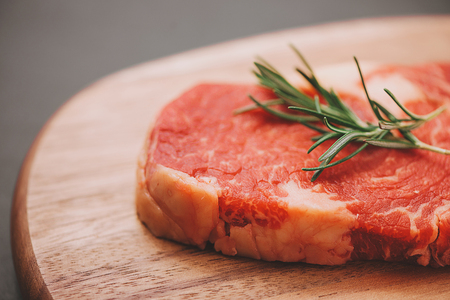 Raw beef cooking with ingredients. Top view with copy space Stockfoto