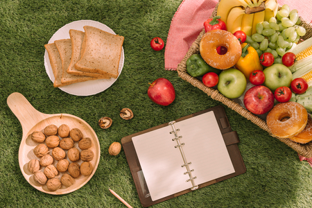 picnic basket with fruit on a plaid in the summer park Stok Fotoğraf