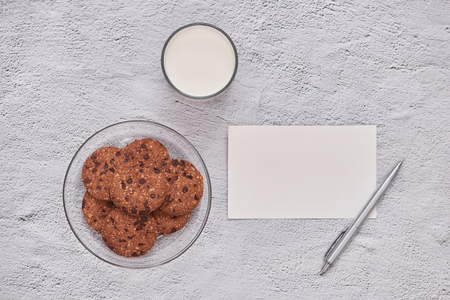 homemade oatmeal cookies with chocolate on an old white background.
