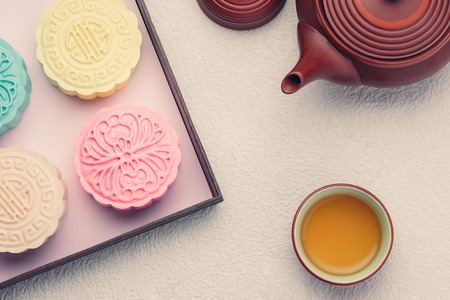 Retro vintage style Chinese mid autumn festival foods. Traditional mooncakes on table setting Stok Fotoğraf - 102931001