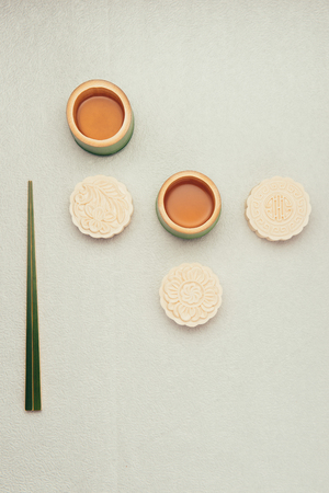 Mooncake and tea, Chinese mid autumn festival food. Angle view from above