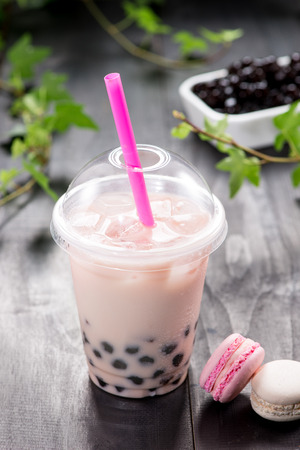 Strawberry Boba Bubble Tea with fruits and crushed ice.