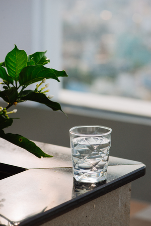 Closeup Glass of water on table nature background Reklamní fotografie