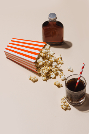 Popcorn in red and white cardboard with glass of soda Stok Fotoğraf