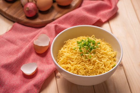 instant noodles in bowl with vegetable.